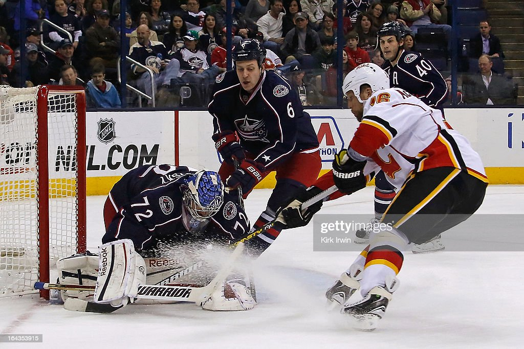 Sergei Bobrovsky #72 of the Columbus Blue Jackets makes a save against Brian McGrattan #16 of the Calgary Flames during the third period on March 22, 2013 at Nationwide Arena in Columbus, Ohio. Columbus defeated Calgary 5-1.