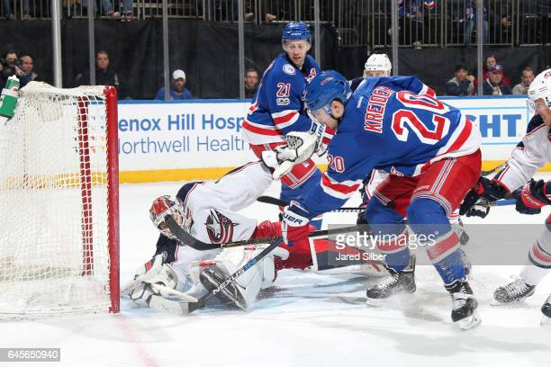 Sergei Bobrovsky of the Columbus Blue Jackets makes a save against Chris Kreider of the New York Rangers at Madison Square Garden on February 26 2017...