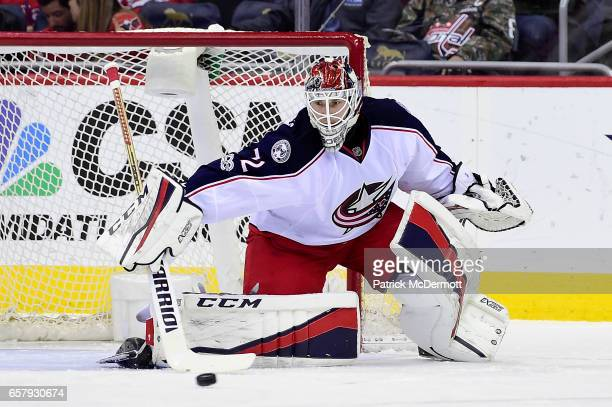 Sergei Bobrovsky of the Columbus Blue Jackets makes a save against the Washington Capitals in the first period during an NHL game at Verizon Center...