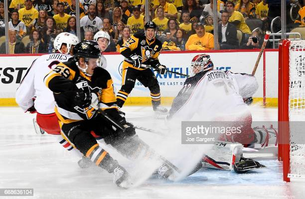 Sergei Bobrovsky of the Columbus Blue Jackets makes a save against Jake Guentzel of the Pittsburgh Penguins in Game Two of the Eastern Conference...