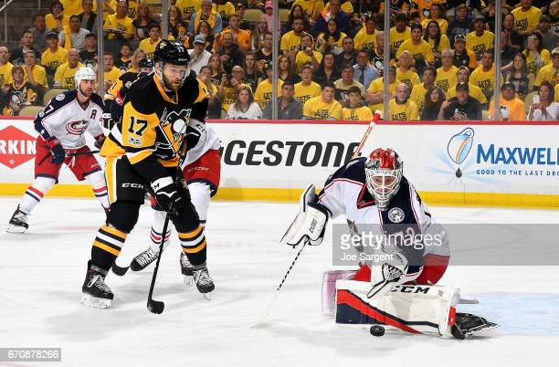 Sergei Bobrovsky of the Columbus Blue Jackets makes a save against Bryan Rust of the Pittsburgh Penguins in Game Five of the Eastern Conference First...