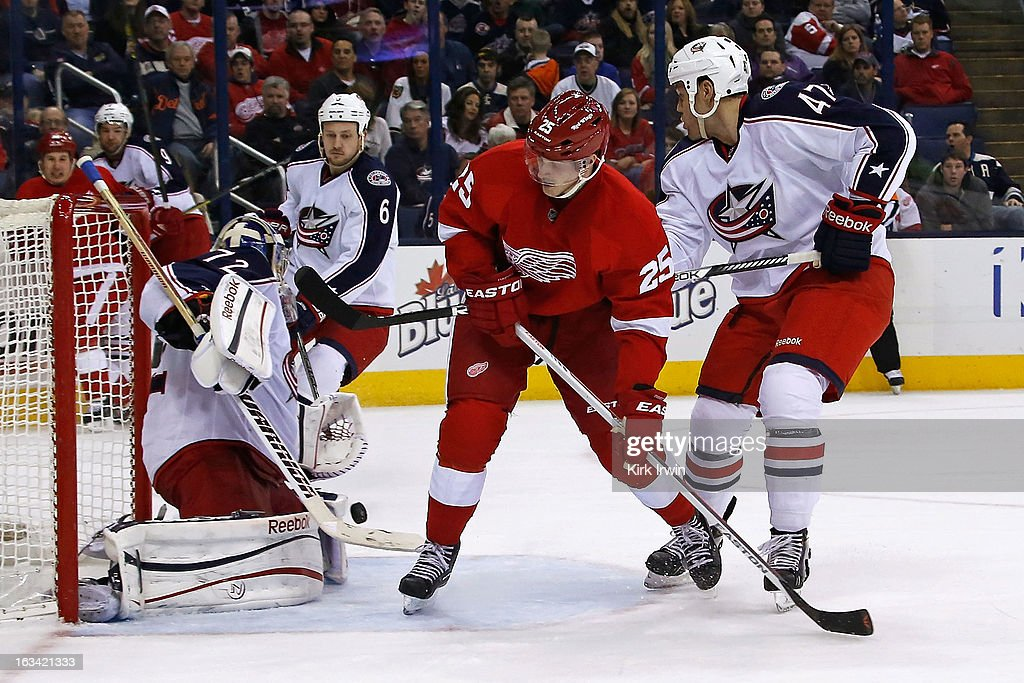 <a gi-track='captionPersonalityLinkClicked' href=/galleries/search?phrase=Sergei+Bobrovsky&family=editorial&specificpeople=4488556 ng-click='$event.stopPropagation()'>Sergei Bobrovsky</a> #72 of the Columbus Blue Jackets makes a save as <a gi-track='captionPersonalityLinkClicked' href=/galleries/search?phrase=Cory+Emmerton&family=editorial&specificpeople=570505 ng-click='$event.stopPropagation()'>Cory Emmerton</a> #25 of the Detroit Red Wings is defended by <a gi-track='captionPersonalityLinkClicked' href=/galleries/search?phrase=Dalton+Prout&family=editorial&specificpeople=6263673 ng-click='$event.stopPropagation()'>Dalton Prout</a> #47 of the Columbus Blue Jackets on March 9, 2013 at Nationwide Arena in Columbus, Ohio. Brobrovsky stopped all 30 shots he faced as Columbus defeated Detroit 3-0 for the team's first shutout of the season and Brobovsky's first career shutout.