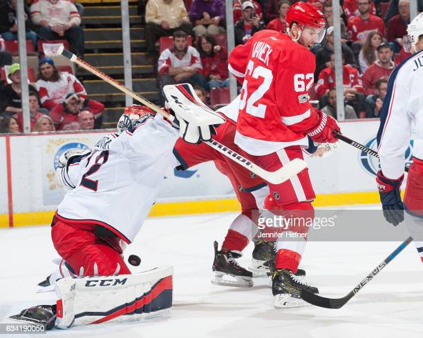 Sergei Bobrovsky of the Columbus Blue Jackets makes a save as Thomas Vanek of the Detroit Red Wings screens him infront of the net during an NHL game...