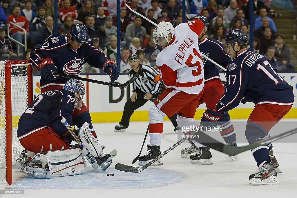 <a gi-track='captionPersonalityLinkClicked' href=/galleries/search?phrase=Sergei+Bobrovsky&family=editorial&specificpeople=4488556 ng-click='$event.stopPropagation()'>Sergei Bobrovsky</a> #72 of the Columbus Blue Jackets makes a save on a shot from <a gi-track='captionPersonalityLinkClicked' href=/galleries/search?phrase=Valtteri+Filppula&family=editorial&specificpeople=2234404 ng-click='$event.stopPropagation()'>Valtteri Filppula</a> #51 of the Detroit Red Wings during the third period on January 21, 2013 at Nationwide Arena in Columbus, Ohio. Detroit defeated Columbus 4-3 in a shootout.