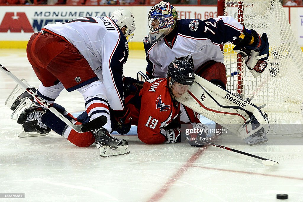 <a gi-track='captionPersonalityLinkClicked' href=/galleries/search?phrase=Sergei+Bobrovsky&family=editorial&specificpeople=4488556 ng-click='$event.stopPropagation()'>Sergei Bobrovsky</a> #72 of the Columbus Blue Jackets makes a save on a shot by Nicklas Backstrom #19 of the Washington Capitals in the third period at the Verizon Center on October 19, 2013 in Washington, DC.