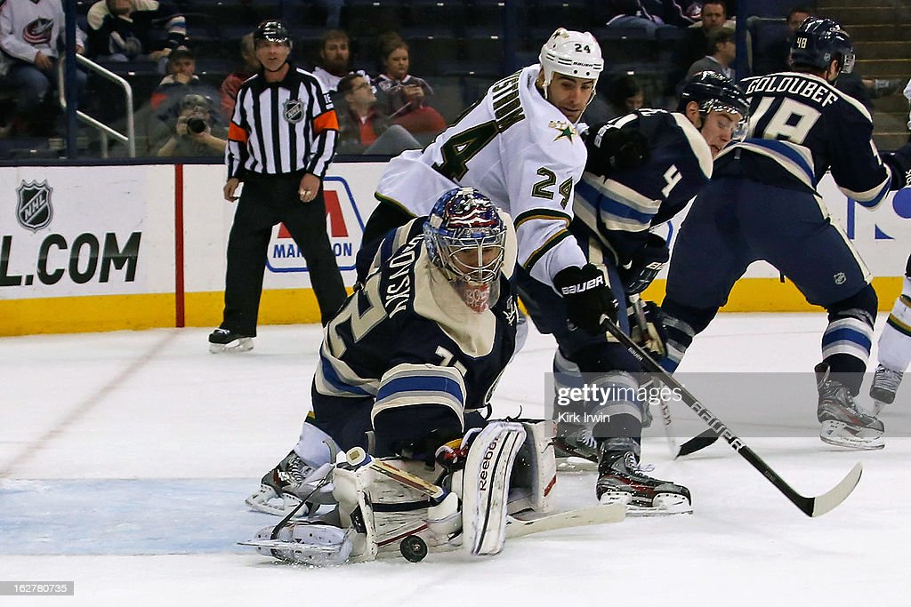 <a gi-track='captionPersonalityLinkClicked' href=/galleries/search?phrase=Sergei+Bobrovsky&family=editorial&specificpeople=4488556 ng-click='$event.stopPropagation()'>Sergei Bobrovsky</a> #72 of the Columbus Blue Jackets makes as save as <a gi-track='captionPersonalityLinkClicked' href=/galleries/search?phrase=Eric+Nystrom&family=editorial&specificpeople=2209813 ng-click='$event.stopPropagation()'>Eric Nystrom</a> #24 of the Dallas Stars and John Moore #4 of the Columbus Blue Jackets battle for position in front of the net on February 26, 2013 at Nationwide Arena in Columbus, Ohio. Dallas defeated Columbus 5-4 in overtime.