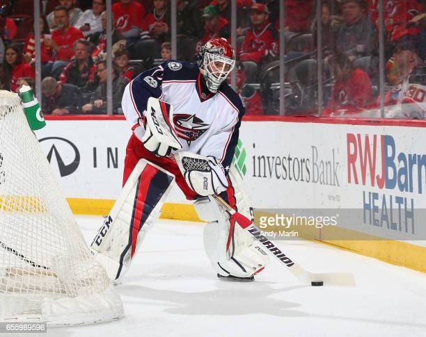 Sergei Bobrovsky of the Columbus Blue Jackets plays the puck against the New Jersey Devils during the game at Prudential Center on March 19 2017 in...