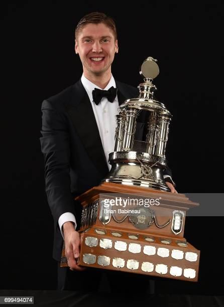 Sergei Bobrovsky of the Columbus Blue Jackets poses for a portrait with the Vezina Trophy at the 2017 NHL Awards at TMobile Arena on June 21 2017 in...