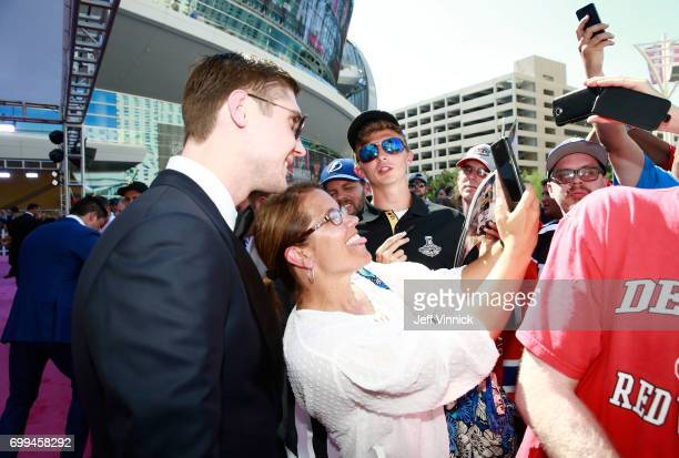 Sergei Bobrovsky of the Columbus Blue Jackets poses for a selfie photo as he arrives on the magenta carpet for the 2017 NHL Awards at TMobile Arena...