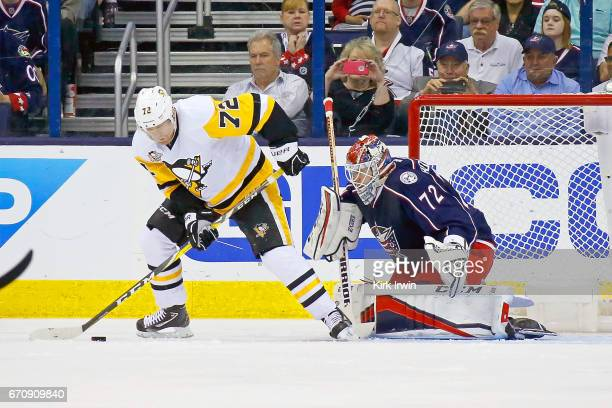 Sergei Bobrovsky of the Columbus Blue Jackets prepares to stop a shot from Patric Hornqvist of the Pittsburgh Penguins in Game Four of the Eastern...