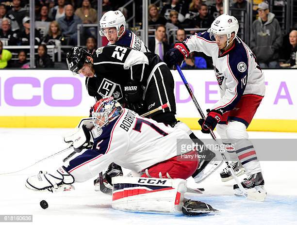 Sergei Bobrovsky of the Columbus Blue Jackets smothers the puck in front of Dustin Brown of the Los Angeles Kings during the second period at Staples...