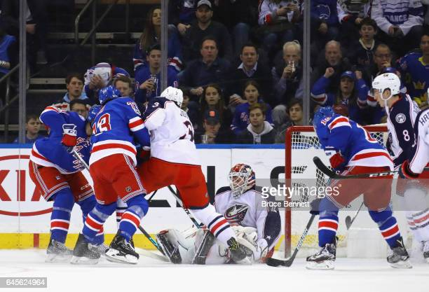 Sergei Bobrovsky of the Columbus Blue Jackets smothers the puck against the New York Rangers during the first period at Madison Square Garden on...