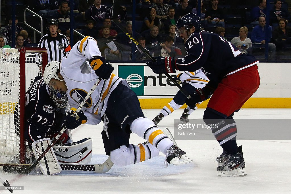 Sergei Bobrovsky #72 of the Columbus Blue Jackets stops a shot as Corey Tropp #78 of the Buffalo Sabres is checked by Tim Erixon #20 of the Columbus Blue Jackets during the first period on September, 2013 at Nationwide Arena in Columbus, Ohio.
