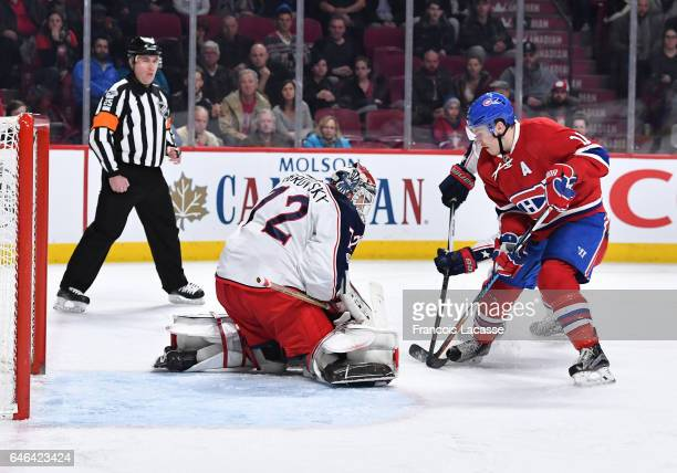Sergei Bobrovsky of the Columbus Blue Jackets stops a shot by Brendan Gallagher of the Montreal Canadiens in the NHL game at the Bell Centre on...