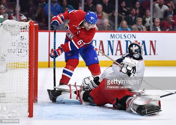 Sergei Bobrovsky of the Columbus Blue Jackets stops a shot by Max Pacioretty of the Montreal Canadiens in the NHL game at the Bell Centre on February...