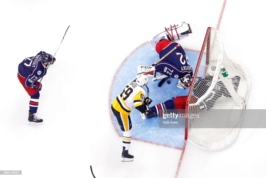 Sergei Bobrovsky #72 of the Columbus Blue Jackets stops a shot from Jake Guentzel #59 of the Pittsburgh Penguins during the third period of Game Three of the Eastern Conference First Round during the 2017 NHL Stanley Cup Playoffs on April 16, 2017 at Nationwide Arena in Columbus, Ohio. Pittsburgh defeated Columbus 5-4 in overtime. Pittsburgh leads the series 3-0.