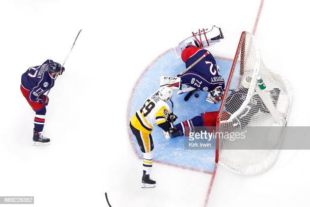 Sergei Bobrovsky of the Columbus Blue Jackets stops a shot from Jake Guentzel of the Pittsburgh Penguins during the third period of Game Three of the...