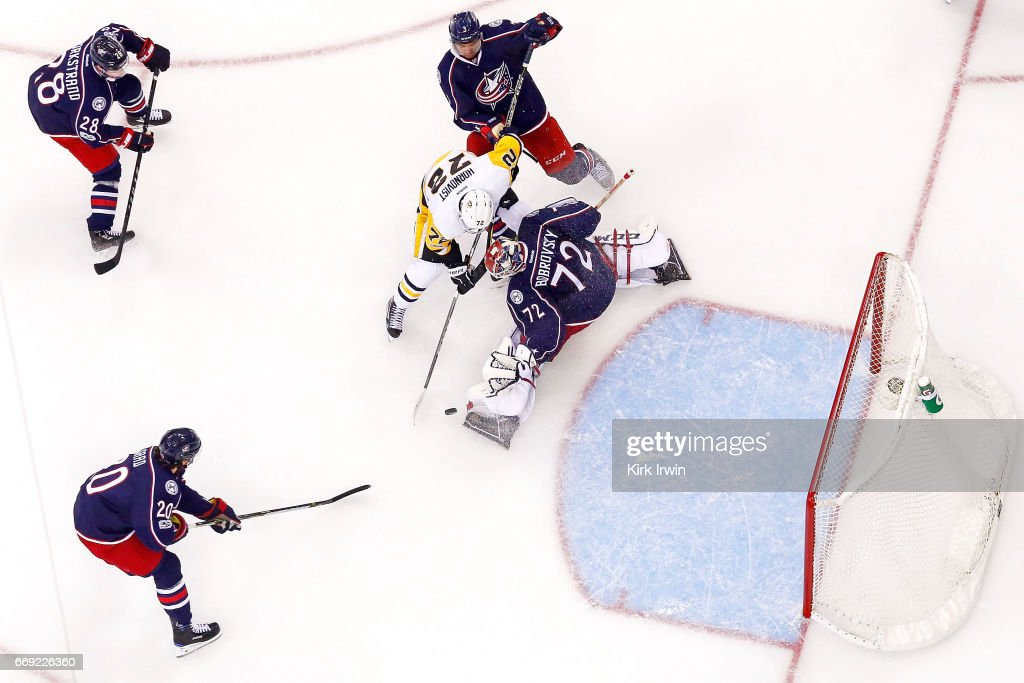 Sergei Bobrovsky #72 of the Columbus Blue Jackets stops a shot from Patric Hornqvist #72 of the Pittsburgh Penguins during the third period of Game Three of the Eastern Conference First Round during the 2017 NHL Stanley Cup Playoffs on April 16, 2017 at Nationwide Arena in Columbus, Ohio. Pittsburgh defeated Columbus 5-4 in overtime. Pittsburgh leads the series 3-0.