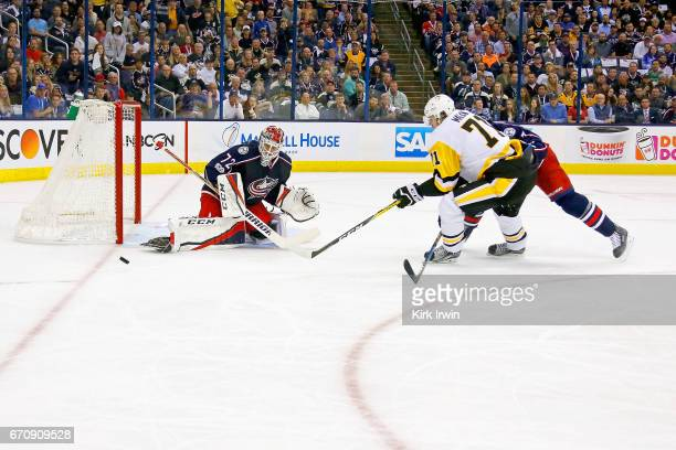 Sergei Bobrovsky of the Columbus Blue Jackets stops a shot from Evgeni Malkin of the Pittsburgh Penguins in Game Four of the Eastern Conference First...