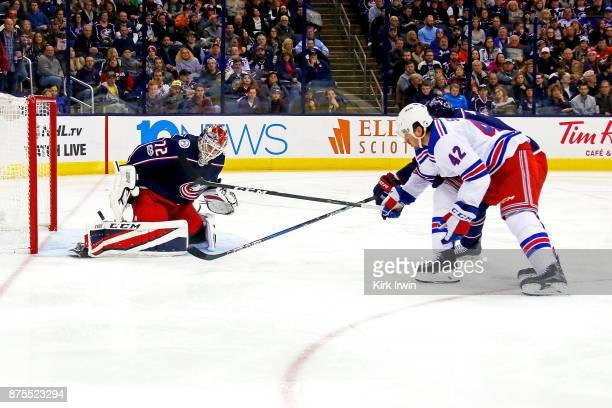 Sergei Bobrovsky of the Columbus Blue Jackets stops a shot from Brendan Smith of the New York Rangers during the third period on November 17 2017 at...