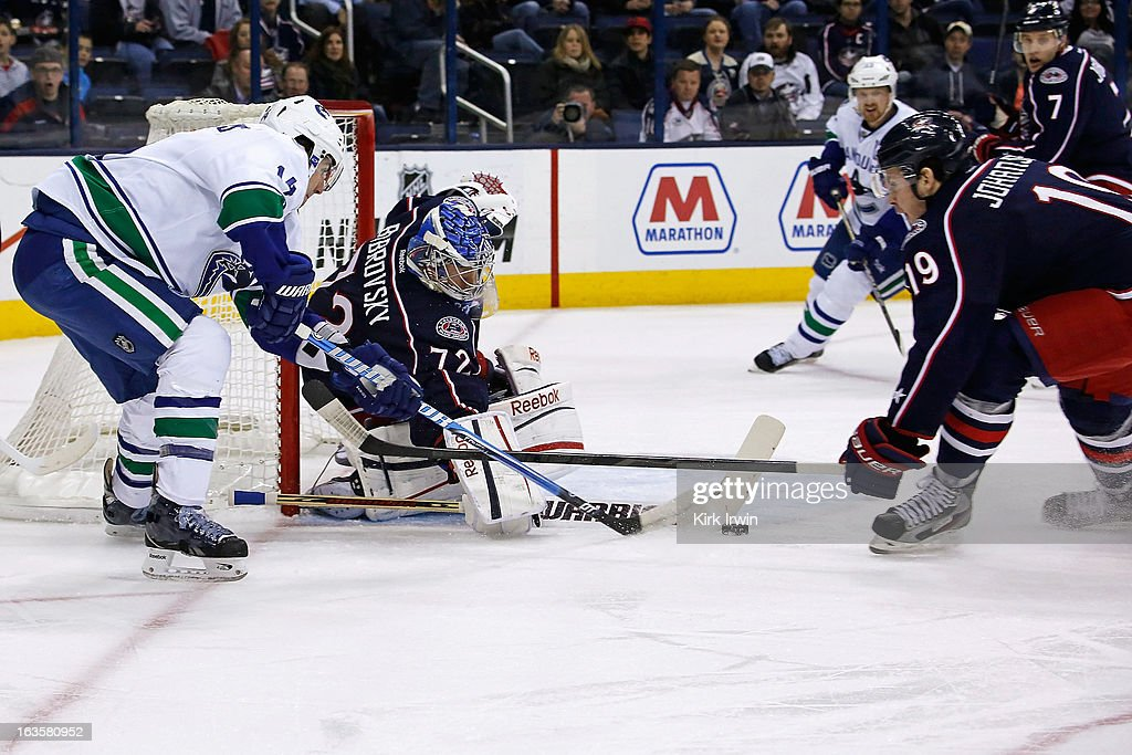 <a gi-track='captionPersonalityLinkClicked' href=/galleries/search?phrase=Sergei+Bobrovsky&family=editorial&specificpeople=4488556 ng-click='$event.stopPropagation()'>Sergei Bobrovsky</a> #72 of the Columbus Blue Jackets stops a wrap around attempt from <a gi-track='captionPersonalityLinkClicked' href=/galleries/search?phrase=Alexandre+Burrows&family=editorial&specificpeople=592489 ng-click='$event.stopPropagation()'>Alexandre Burrows</a> #14 of the Vancouver Canucks as <a gi-track='captionPersonalityLinkClicked' href=/galleries/search?phrase=Ryan+Johansen&family=editorial&specificpeople=6698841 ng-click='$event.stopPropagation()'>Ryan Johansen</a> #19 of the Columbus Blue Jackets attempts to help on defense during the first period on March 12, 2013 at Nationwide Arena in Columbus, Ohio.
