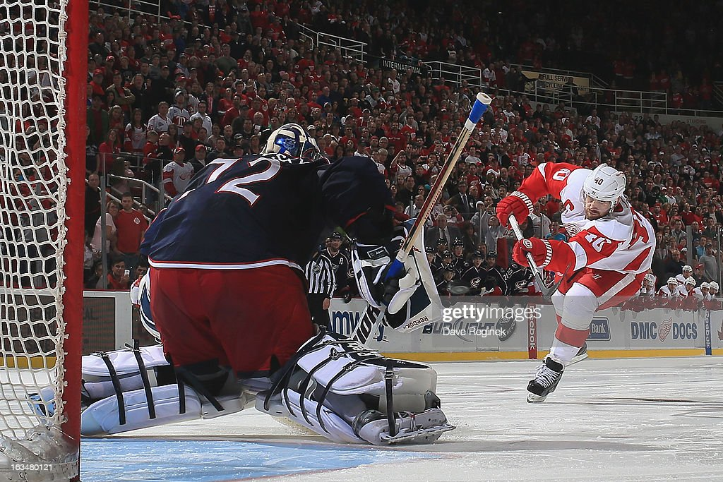 Sergei Bobrovsky #72 of the Columbus Blue Jackets stops <a gi-track='captionPersonalityLinkClicked' href=/galleries/search?phrase=Henrik+Zetterberg&family=editorial&specificpeople=201520 ng-click='$event.stopPropagation()'>Henrik Zetterberg</a> #40 of the Detroit Red Wings on a shoot-out attempt during an NHL game against the at Joe Louis Arena on March 10, 2013 in Detroit, Michigan. Columbus won in a shoot-out 3-2