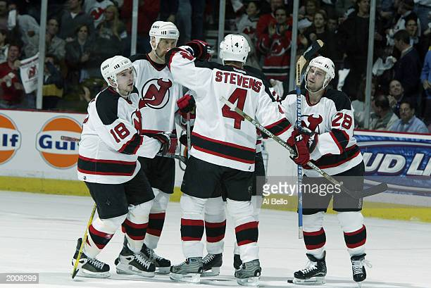 Sergei Brylin of the New Jersey Devils celebrates his first period goal with teammates against the Ottawa Senators during game three of the Eastern...