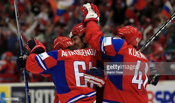 Sergei Fedorov of Russia celebrates with his team mates after he scores his team's fourth goal during the IIHF World Championship quarter final match...