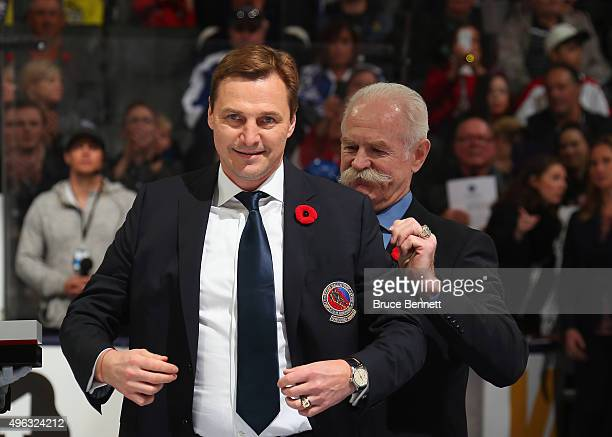 Sergei Fedorov receives his Hockey Hall of Fame blazer from the Chairman of the Hockey Hall of Fame Lanny McDonald prior to the Legends Classic game...