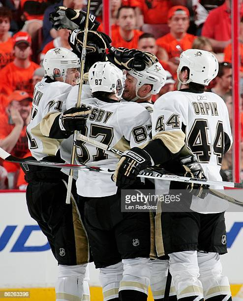 Sergei Gonchar is mobbed by Evgeni Malkin Sidney Crosby and Brooks Orpik of the Pittsburgh Penguins after scoring a goal against the Philadelphia...