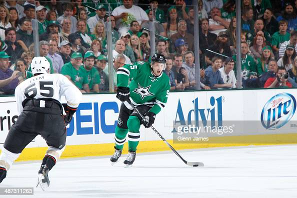 Sergei Gonchar of the Dallas Stars handles the puck against Emerson Etem of the Anaheim Ducks in Game Four of the First Round of the 2014 Stanley Cup...