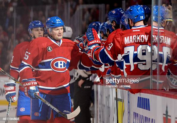 Sergei Gonchar of the Montreal Canadiens celebrates with the bench after a goal against the Tampa Bay Lightning in the NHL game at the Bell Centre on...