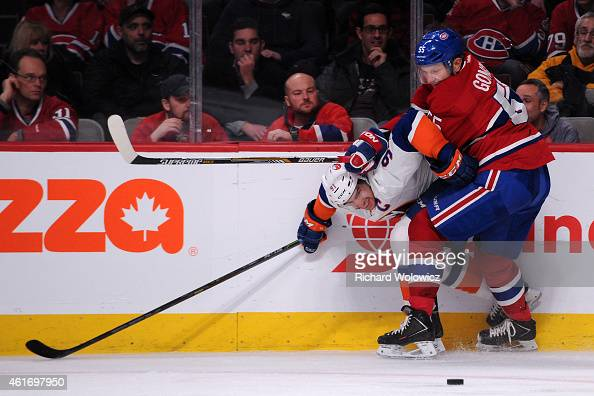 Sergei Gonchar of the Montreal Canadiens defends against John Tavares of the New York Islanders during the NHL game at the Bell Centre on January 17...
