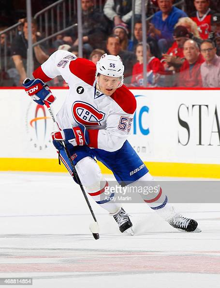 Sergei Gonchar of the Montreal Canadiens plays the puck against the New Jersey Devils during the game at the Prudential Center on April 3 2015 in...
