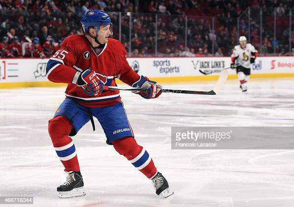 Sergei Gonchar of the Montreal Canadiens skates for the puck against the Ottawa Senators in the NHL game at the Bell Centre on March 12 2015 in...