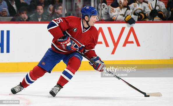 Sergei Gonchar of the Montreal Canadiens skates with the puck against the Buffalo Sabres in the NHL game at the Bell Centre on February 3 2015 in...