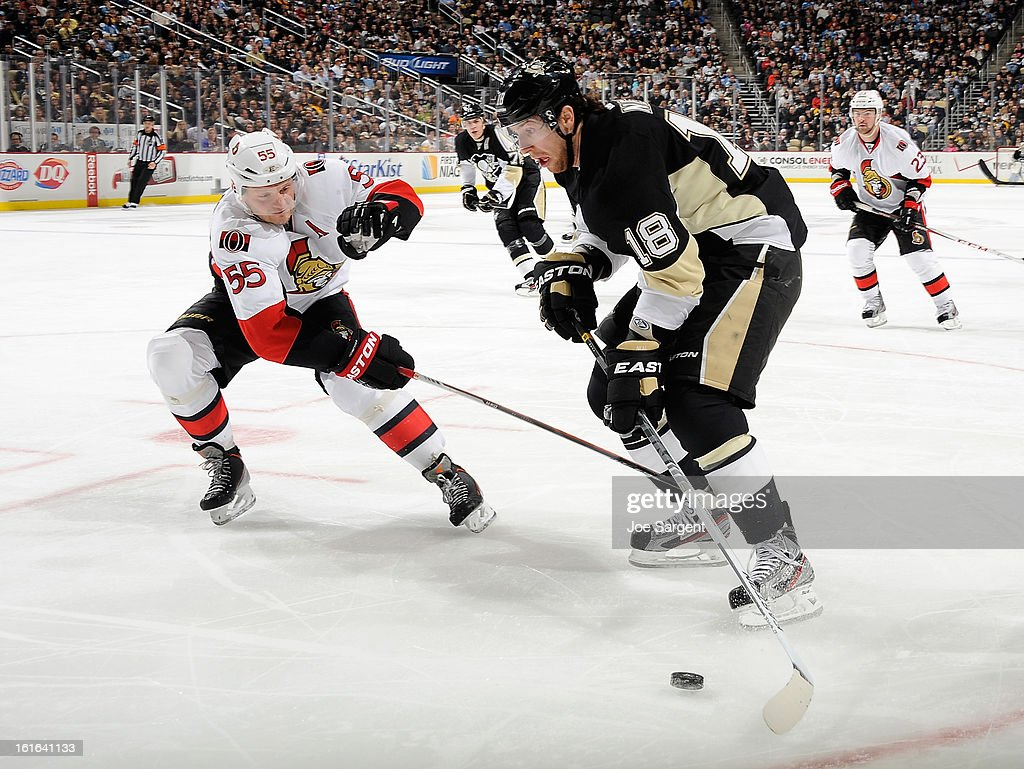 <a gi-track='captionPersonalityLinkClicked' href=/galleries/search?phrase=Sergei+Gonchar&family=editorial&specificpeople=202470 ng-click='$event.stopPropagation()'>Sergei Gonchar</a> #55 of the Ottawa Senators battles for the puck against <a gi-track='captionPersonalityLinkClicked' href=/galleries/search?phrase=James+Neal&family=editorial&specificpeople=1487991 ng-click='$event.stopPropagation()'>James Neal</a> #18 of the Pittsburgh Penguins on February 13, 2013 at Consol Energy Center in Pittsburgh, Pennsylvania.