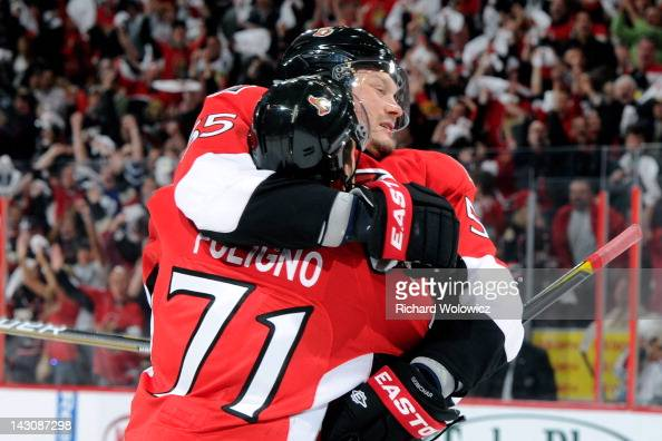 Sergei Gonchar of the Ottawa Senators celebrates his second period goal with teammate Nick Foligno in Game Four of the Eastern Conference...