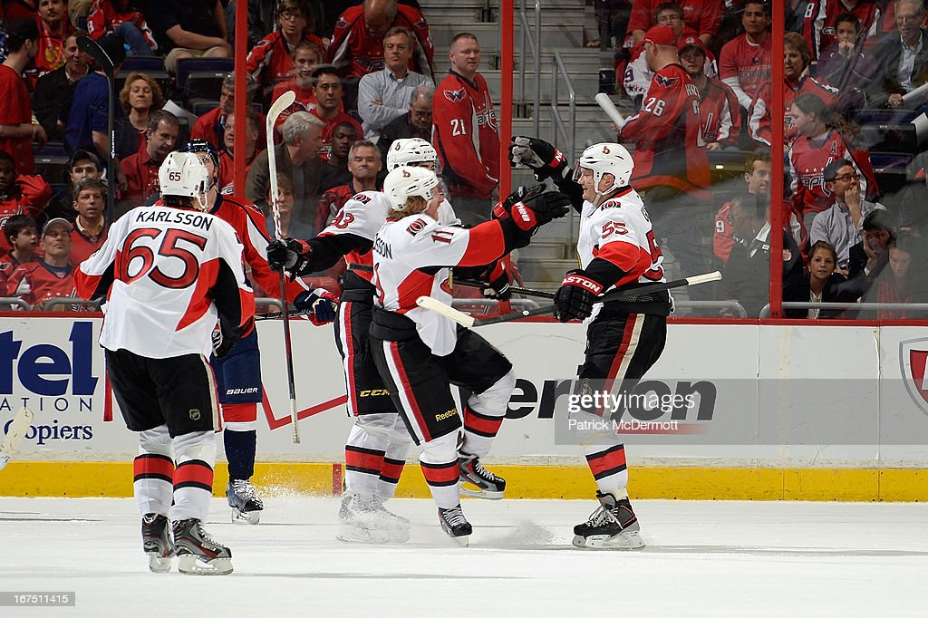 <a gi-track='captionPersonalityLinkClicked' href=/galleries/search?phrase=Sergei+Gonchar&family=editorial&specificpeople=202470 ng-click='$event.stopPropagation()'>Sergei Gonchar</a> #55 of the Ottawa Senators celebrates with teammates after his game winning goal during an NHL game against the Washington Capitals at Verizon Center on April 25, 2013 in Washington, DC.