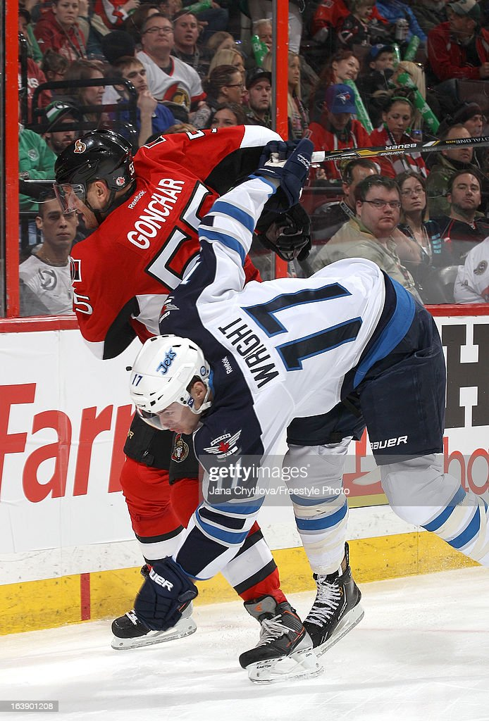 Sergei Gonchar #55 of the Ottawa Senators collides with James Wright #17 of the Winnipeg Jets, during an NHL game at Scotiabank Place, on March 17, 2013 in Ottawa, Ontario, Canada.