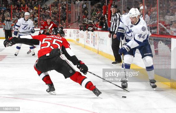 Sergei Gonchar of the Ottawa Senators defends the defensive zone as Nate Thompson of the Tampa Bay Lightning stickhandles the puck at Scotiabank...