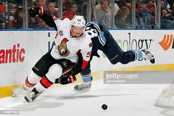Sergei Gonchar of the Ottawa Senators eludes the check by Tomas Kopecky of the Florida Panthers as he chases the puck on March 4 2012 at the...