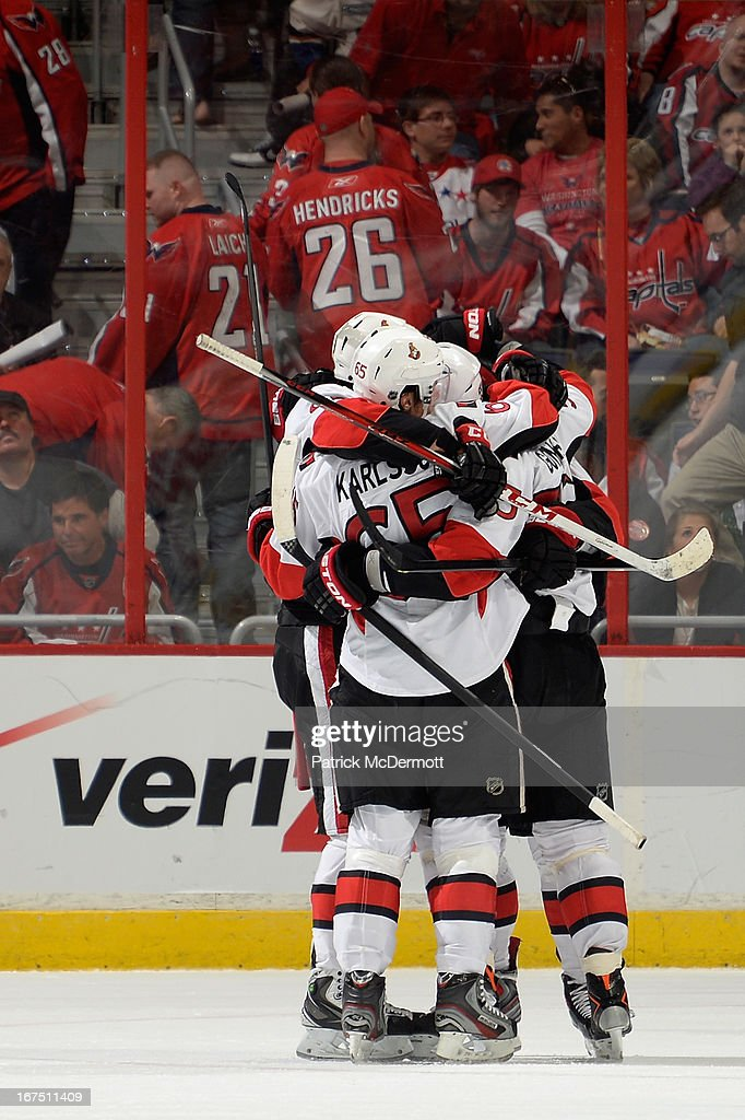 <a gi-track='captionPersonalityLinkClicked' href=/galleries/search?phrase=Sergei+Gonchar&family=editorial&specificpeople=202470 ng-click='$event.stopPropagation()'>Sergei Gonchar</a> #55 of the Ottawa Senators is congratulated by teammates after his overtime game winning goal during an NHL game against the Washington Capitals at Verizon Center on April 25, 2013 in Washington, DC.