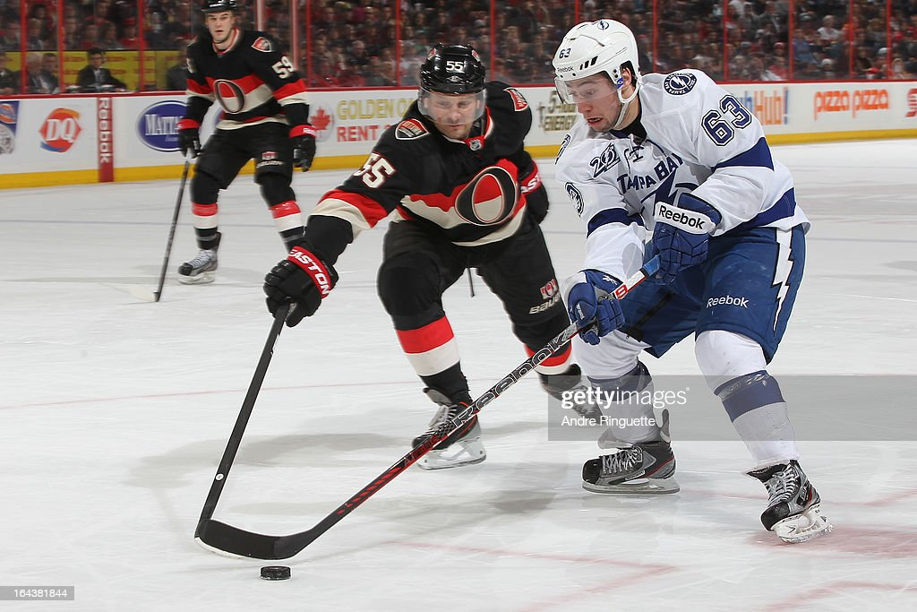 <a gi-track='captionPersonalityLinkClicked' href=/galleries/search?phrase=Sergei+Gonchar&family=editorial&specificpeople=202470 ng-click='$event.stopPropagation()'>Sergei Gonchar</a> #55 of the Ottawa Senators reaches to stick check the puck away from <a gi-track='captionPersonalityLinkClicked' href=/galleries/search?phrase=Tyler+Johnson+-+Ice+Hockey+Player&family=editorial&specificpeople=14574766 ng-click='$event.stopPropagation()'>Tyler Johnson</a> #63 of the Tampa Bay Lightning on March 23, 2013 at Scotiabank Place in Ottawa, Ontario, Canada.