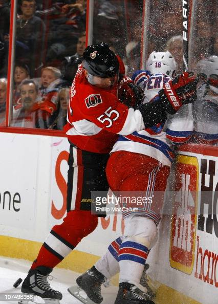 Sergei Gonchar of the Ottawa Senators runs Sean Avery of the New York Rangers into the end boards at Scotiabank Place on December 9 2010 in Ottawa...