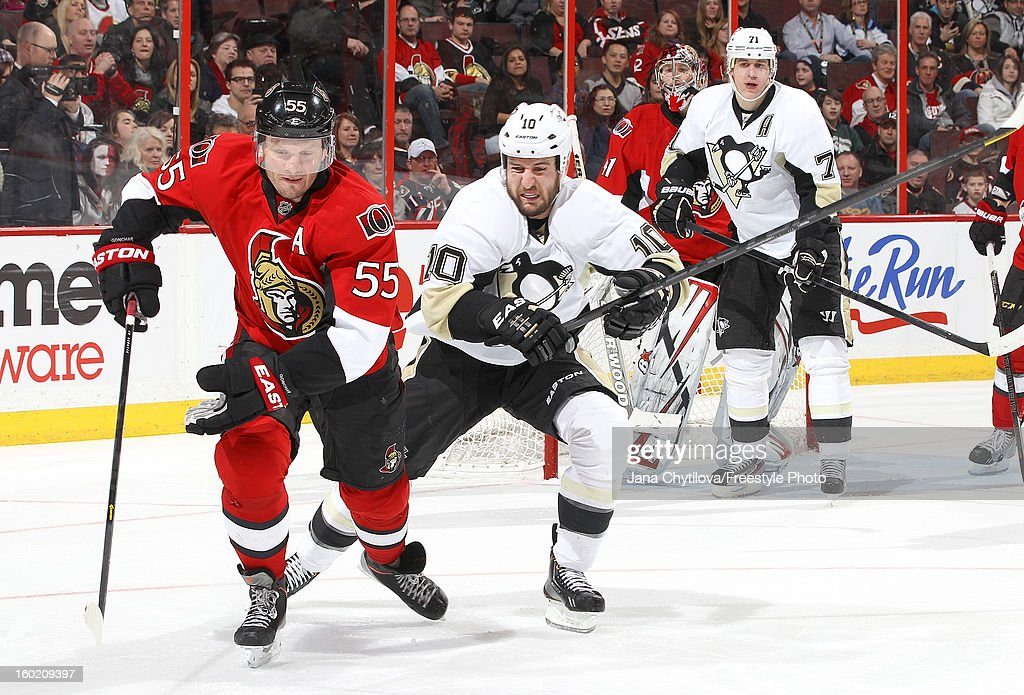 Sergei Gonchar #55 of the Ottawa Senators skates against <a gi-track='captionPersonalityLinkClicked' href=/galleries/search?phrase=Tanner+Glass&family=editorial&specificpeople=4596666 ng-click='$event.stopPropagation()'>Tanner Glass</a> #10 of the Pittsburgh Penguins during an NHL game at Scotiabank Place on January 27, 2013 in Ottawa, Ontario, Canada.