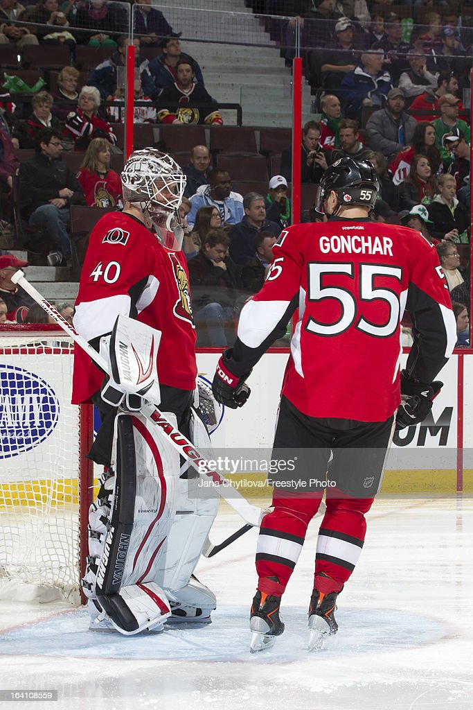 Sergei Gonchar #55 of the Ottawa Senators taps the pads of teammate Robin Lehner #40 prior to the start of an NHL game against the Winnipeg Jets at Scotiabank Place on March 17, 2013 in Ottawa, Ontario, Canada.