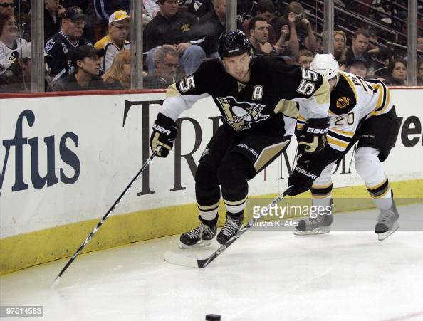 Sergei Gonchar of the Pittsburgh Penguins handles the puck by Daniel Paille of the Boston Bruins in the third period at Mellon Arena on March 7 2010...