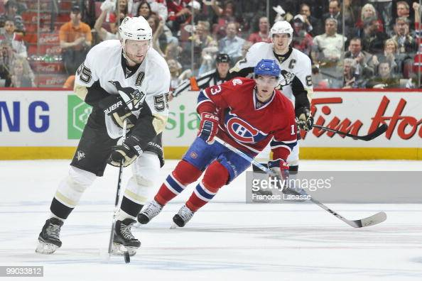Sergei Gonchar of the Pittsburgh Penguins makes a pass in front of Mike Cammalleri of Montreal Canadiens in Game Four of the Eastern Conference...