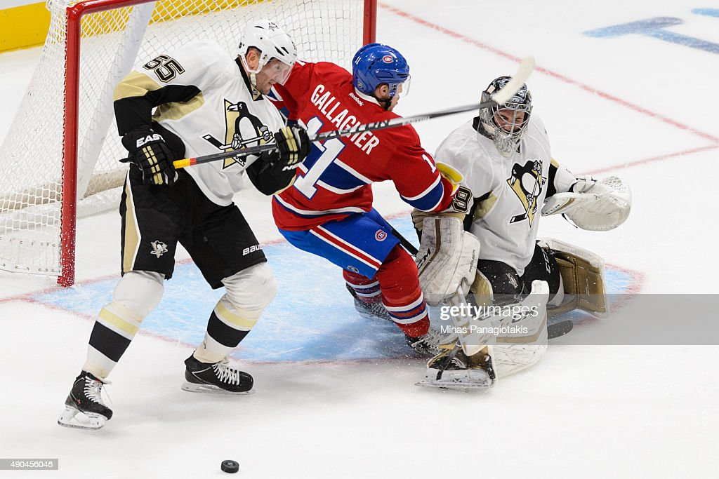Sergei Gonchar #55 of the Pittsburgh Penguins tries to defend against Brendan Gallagher #11 of the Montreal Canadiens near goaltender Marc-Andre Fleury #29 during an NHL pre-season game at the Videotron Centre on September 28, 2015 in Quebec City, Quebec, Canada.